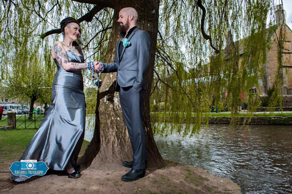 Couple in handfasting ceremoy